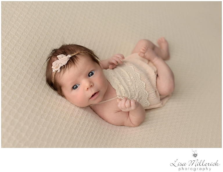 Bright eyed newborn baby girl picture