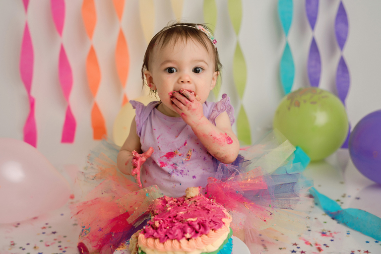 girl rainbow baby one fun cake smash